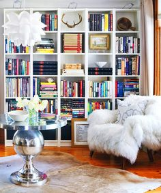 Would love to take one of the smaller walls in our new living room and cover it completely with a bookshelf