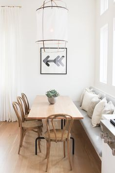 DINING: gorgeous monochrome dining space with timber table and timber bentwood chairs + built in bench seat
