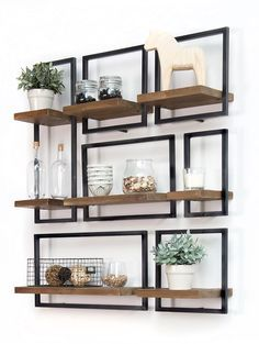 SHELFMATE, in short: a piece of premium teak that floats. in a stylish, black iron frame. The combination of wood and iron is the signature of d-Bodhi. , SHELFMATE in short: A piece of premium teak wood that 'floats' in… Continue Reading → Manly Living Room, Home And Living, Living Room Decor, Wood Living Rooms, Modern Living, Ikea Interior, Interior Design, Interior Ideas, Diy Home