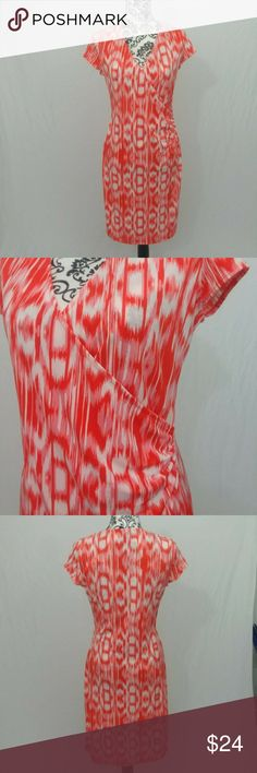 "Jones New York Midi Wrap Dress Size small. Red, pink & white printed short sleeve midi length wrap dress. Approximate Measurements: Pit to pit measures 17.5"". Hips are 35"". Length is 36"". Measurements taken while laying flat. Jones New York Dresses Midi"