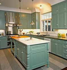 green/teal.Any set of kitchen cabinets can be turned into these.  The wainscotting and decorative trim and legs can be added to any set of cabinets for a fraction of the price of new cabinets.