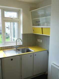 A modern day version of a 50s kitchen - stupendous!   Your Home is Lovely: chic interiors on a budget: The house the 50s built
