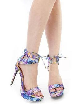 These sexy and stylish platform high heels are a must have! The features include a fabric upper with a floral print throughout, strap vamp and open toe, cut out ankle strappy design with string bow tie accent, back zipper closure, smooth lining, and cushioned footbed. Approximately 5 1/4 inch heels and 1 inch platforms. Platform High Heels, High Heel Pumps, Pumps Heels, Stiletto Heels, Spring Shoes, Summer Shoes, Floral Heels, Prom Shoes, 4 Inch Heels
