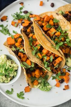 Sweet Potato Tacos that feature sweet potatoes cooked in a chipotle sauce, tossed with black beans, and served with guacamole to balance the heat.