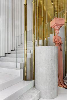 La boutique Vionnet à Paris  Brass and concrete staircase