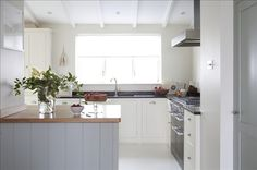 Chefs kitchen. Mousehole, Cornwall. Mercury cooker. Painted cabinets. Seaside life. Family home.