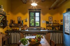 An enchanting XVI Century 3-Story Villa situated in the beautiful countryside of Siena, a few...