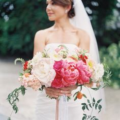 Peony filled bouquet: http://www.stylemepretty.com/2014/05/23/romance-color-at-villa-woodbine/   Photography: Kat Braman - http://www.katbramanphotography.com/