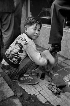 Shoeshine boy, Tokyo, Japan, 1951 by Werner Bischof