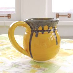 NEW Spring color -- a happy crocus yellow Wheel-thrown coffee cup great for coffee and tea drinking too! The listing is for ONE pretty yellow coffee mug, tea cup. Wheel-thrown white earthenware mug, g