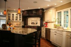 khaki walls, white cabs, terra cotta tile-- maybe a freshening up option for my tired kitchen?