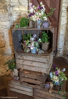 A classic 'Rustic' alternative crate stack design at Cripps Barn by top Bristol florists, The Wilde Bunch. All these floral designs were moved back to the breakfast to compliment the table flowers making these 'statement' designs very cost effective. Cripps Barn Wedding, Barn Wedding Venue, Barn Wedding Flowers, Stone Barns, Table Flowers, Florists, Floral Designs, Bristol, Ladder Decor