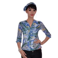 Three-quarter sleeved blue printed chiffon blouse with cuffs at wrist. Self tying-belt. Front button opening. Please note model wears her own tank top inside. Comes with matching slim scarf. Matches nicely with Eva Scarf as well. $25.70