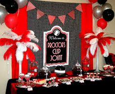 Individual decorated food buffets in different areas (I like this but maybe with out red and more black and white and shiny silver or gold)