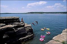Greers Ferry Lake, Heber Springs, Arkansas.  Camp at the Dam Site, fish for trout in the little red river, eat at a local restaurant, canoe down the river, ski across the lake, climb Sugar Loaf Mountain.