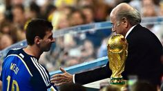 Achingly Close: Lionel Messi accepts his Golden Ball award just feet away from the World Cup he covets so badly.