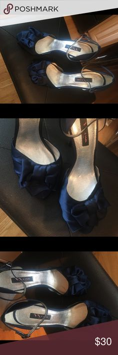 Nina Satin Peep Toe Pumps in Navy Blue Size 11 The perfect something blue wedding shoe size 11. Never worn. I just used for a photo shoot because my feet don't handle heels well. Gorgeous. The heel is between 3-4 inches. I can get exact measurements for you if interested! Nina Shoes Heels