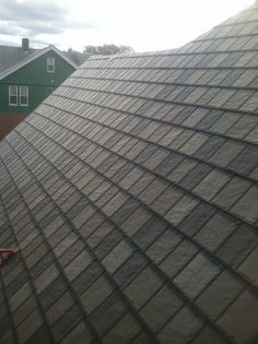 Look closely at this brown tone 'slate' roof - it's actually metal!  Arrowline Enhanced Blend Slate Metal Roofing.  We install Arrowline #roofing in the Minneapolis and St. Paul MN area.  http://www.quarve.com
