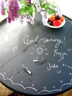 An old table covered in chalk board paint becomes a fun place to eat.
