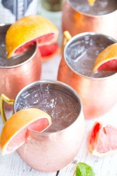 Shake up happy hour with Grapefruit Moscow Mules! Fresh grapefruit juice, ginger beer, and vodka are the stars in this delicious cocktail. Grapefruit Juice And Vodka, Grapefruit Cocktail, Lime Juice, Pineapple Juice, Summer Cocktails, Cocktail Drinks, Cocktail Recipes, Cocktail Ideas, Margarita Recipes