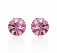 Exquisite    Earrings    Exquisite earrings with cubic zirconia made of 925 sterling silver. Total item weight 0.5g. Gemstone info: 2 cubic zirconia, 0.90ctw., round shape and pink color.