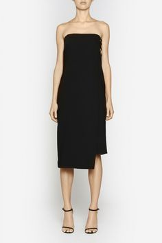 Camilla and Marc | EQUIVALENCE DRESS  US$603.04 Sophisticated cocktail dress designed in a high quality black silk and twill. Created in a streamlined silhouette, this elegant piece features a wrap-style design with two gold buckles located at the left hand side. A subtle asymmetrical hemline provides added interest.