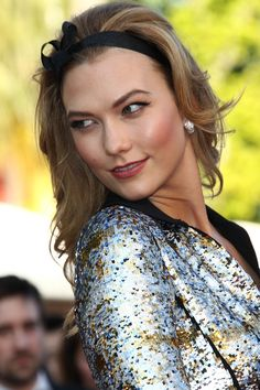 Karlie Kloss makes a serious case for the red carpet headband at Cannes.