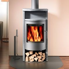 The Rais Bando Wood Stove is a sibling of the Malta but constructed with all solid soapstone sides and top. The beauty and thermal radiance of the soapstone makes the Bando an incredible stove for any home. Stove Fireplace, Fireplace Remodel, High Efficiency Wood Stove, Wood Burning Logs, New Stove, Freestanding Fireplace, Modern Ranch, Kitchen Stove, Houses
