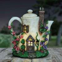 Coffee Pot Fairy House Nightlight Illuminated A fairies have created a charming fairy cottage in a coffee pot. It is battery operated and features an automatic four hour timer making this an ideal nightlight for the fairy lover in your house. Twig Crafts, Clay Crafts, Diy And Crafts, Clay Fairy House, Fairy Garden Houses, Bottle Art, Bottle Crafts, Polymer Clay Fairy, Fairy Garden Furniture