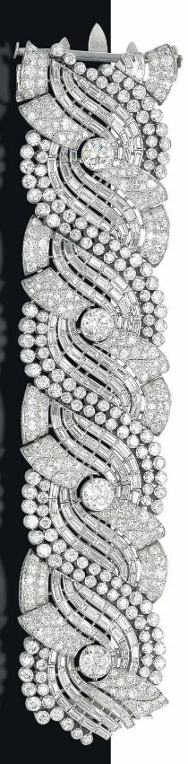 AN IMPRESSIVE ART DECO DIAMOND BRACELET The broad band composed of four pavé-set diamond scrolls, each centering upon a circular-cut diamond collet, flanked with baguette and circular-cut diamond scrolling lines, mounted in platinum, 1930s, 17.9 cm #tiffany cheap replica tiffany jewelry