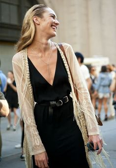 A fringe cardi adds a boho twist to Candice Swanepoel's classic LBD.