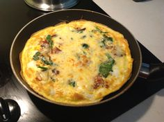Mushroom, bacon, spinach frittata with cheese