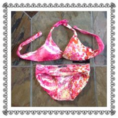 NWT Carmen Marc Valvo 2pc Bikini Lovely shades of pink, red, orange, cream and gold adorn this bold 2 piece tie dye print bikini. Brand new with tags, never worn. Hygienic liner is in place. Top and bottom are both medium and seem true to size. Soft neck and back ties, removable shaper pads. Beautiful twist design at center bust and at hips. Top has boning which offers more support for those more busty gals. Top and bottom are fully lined. You can see and feel the quality in this garment…