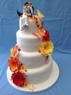 Bright & beautiful sugar flowers on 4 tier wedding cake with edible lace
