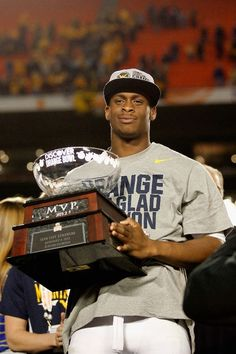 MIAMI GARDENS, FL - JANUARY 04:  Geno Smith #12 of the West Virginia Mountaineers celebrates with the trophy after they won 70-33 against the Clemson Tigers during the Discover Orange Bowl at Sun Life Stadium on January 4, 2012 in Miami Gardens, Florida.  (Photo by Mike Ehrmann/Getty Images)