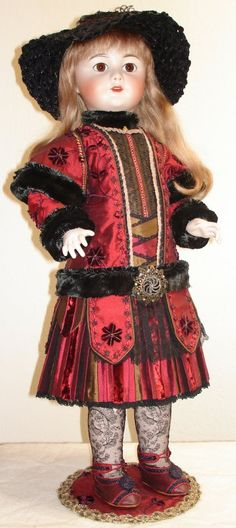 """This is a French Reproduction of Suzanne SFBJ-301 Paris 14.  28"""" size doll on a composition body by Jackie Chimpky. She has glass eyes, mohair upper lashes, a human hair wig, open mouth with teeth and tongue. Her costume is silk w/cotton laces, hand-made shoes and lace socks.   Her costume is embellished w/many trims, piping & tiny gold beads. The neck, cuffs, sash & cape is trimmed w/antique wool fur. Her hat is hand-made with braided straw & wool."""