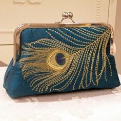 Doesn't get much better than peacock teal and gold. Want.