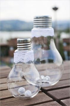 lightbulbs with mini battery powered lights in the bottom #weddinglighting #weddingreception #weddingchicks http://www.weddingchicks.com/2014/03/19/lavender-and-silver-switzerland-wedding/