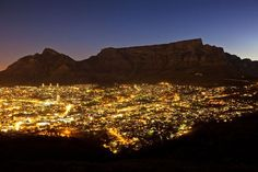 Table Mountain    Photograph by Heiko Meyer, IAIF/Redux    The lights of South Africa's Cape Town illuminate the foot of Table Mountain, another of the world's seven natural wonders as chosen by voters round the world.