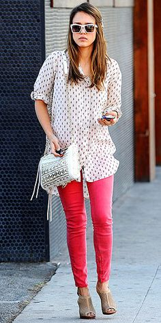 Colored denim and a flowy blouse for a day out in the city. Love this look on Jessica Alba!