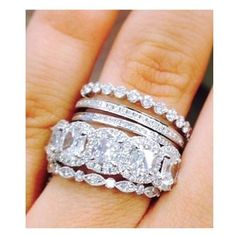 We love @emilygmaynard's Henri Daussi stack #love #diamonds #engaged