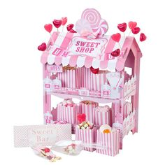 Add a sweet centerpiece to your special event with a Sweet Shop Pink Candy Stand Kit! This candy display pack includes a treat stand, treat bags, a sign, and stickers to personalize it. The two-tier stand has reversible signage. Pony Party, Retro Sweet Shop, Hens Party Themes, Party Ideas, Thema Deco, Sweet Party, Pink Treats, Candy Stand, Tout Rose