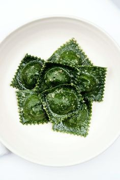 NYT Cooking: For these stunning green-on-green ravioli, stuff a verdant, spinach-packed dough (a modification covered in this basic fresh pasta recipe) with a sweet chard and onion filling. Shaping the ravioli will take some time, so solicit help from friends and family and form an assembly line to speed up the process. Then, set the table and make sure everyone is ready to eat before you drop the pasta in ...