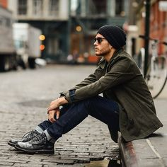 Men's Navy Jeans, Charcoal Leather Boots, Black Beanie, and Olive Pea Coat