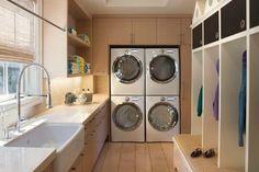 One of my favorite laundry rooms... Dual W & D setup, white porcelain farm sink & built in locker cubbies