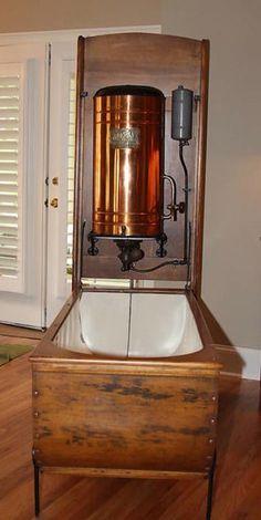 it has a little kerosene heater The Mosely Folding Bath Tub was manufactured in Chicago, Il. Bathtub Shower Combo, Bathtub Tile, Bath Tub, Clawfoot Tubs, Steampunk Bathroom, Victorian Bathroom, Vintage Bathrooms, Victorian House, Bathroom Vanity Lighting