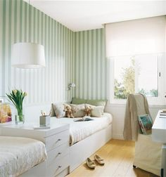 beds against a long wall, vertical blue stripes, storage to separate the sleeping areas, desk, and loads of natural light. one of my fave children's spaces.