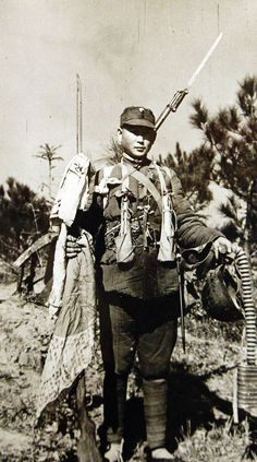 Chinese soldier with captured Japanese equipment, early 1940s #China #Japan #WW2