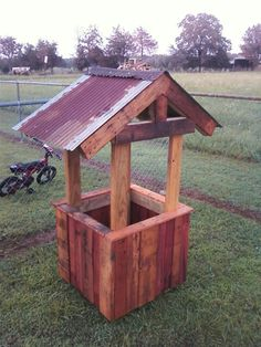 Wishing well made from pallets and treated 2x4's