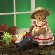 Get yer garden inspiration and motivation from Mrs. Tillington in her summer plaid dress and sun hat! She and her lil' bunny Nibbles are hard at work pickin' veggies and cartin' em to the house in their fully functional wheelbarrow packed with carrots, t